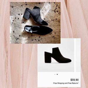 Black heeled slider boots